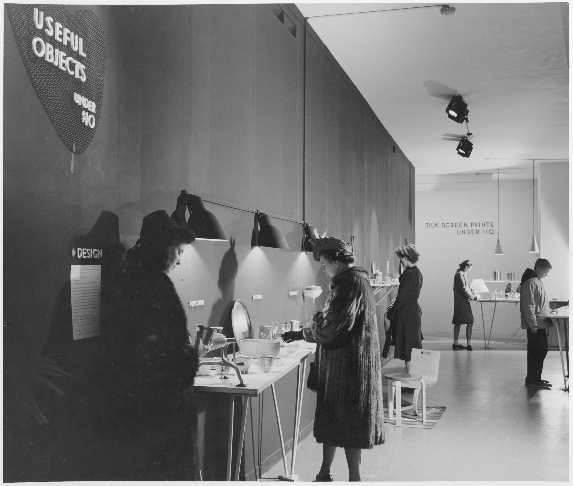 "Unidentified visitors at the exhibition, ""Useful Objects of American Design under $10"" November 26, 1940–December 24, 1940. Photographic Archive. The Museum of Modern Art Archives, New York. IN117.1"