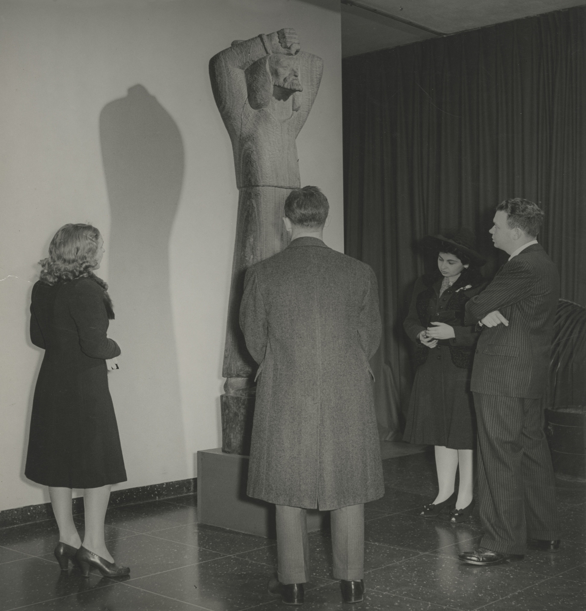 "Visitors at the exhibition, ""New Acquisitions: Latin-American Art"" January 13, 1942–February 15, 1942. Photographic Archive. The Museum of Modern Art Archives, New York. IN165.1. Photograph by Albert Fenn."