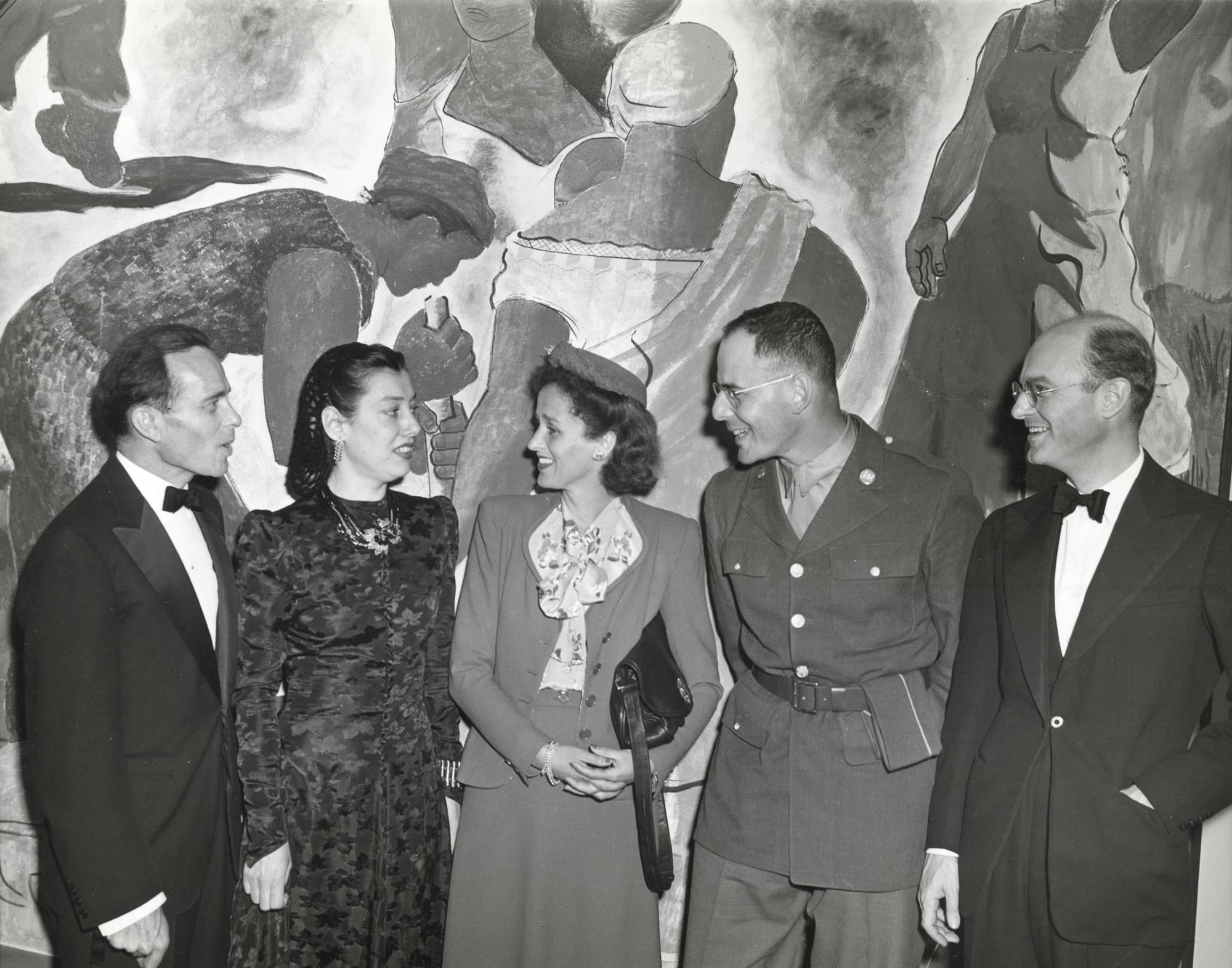 "Attendees at the opening of the exhibition, ""The Latin-American Collection of the Museum of Modern Art,"" left to right: Monroe Wheeler, Mrs. Lincoln Kirstein, Betsy Cushing Roosevelt Whitney, Pvt. Lincoln Kirstein, John E. Abbott March 31, 1943–June 6, 1943. Photographic Archive. The Museum of Modern Art Archives, New York. IN224.1"