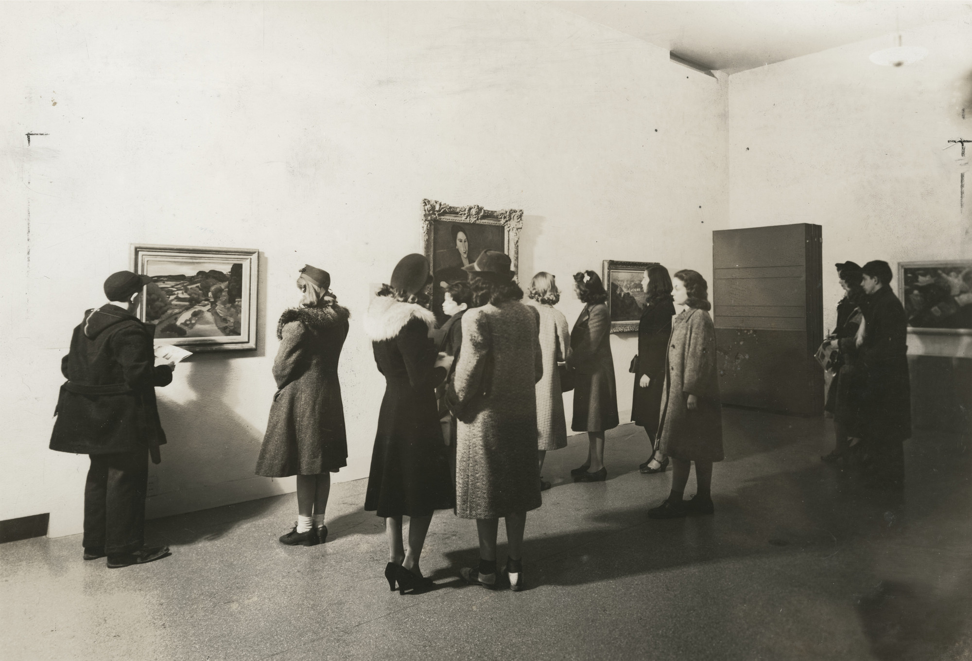 "Installation view of the exhibition, ""12 Favorites:  Paintings Selected by Students from the Museum Collection"" January 31, 1940–March 1, 1940. Victor D'Amico Papers, VI.7. The Museum of Modern Art Archives, New York. IN96.1. Photograph by Soichi Sunami."