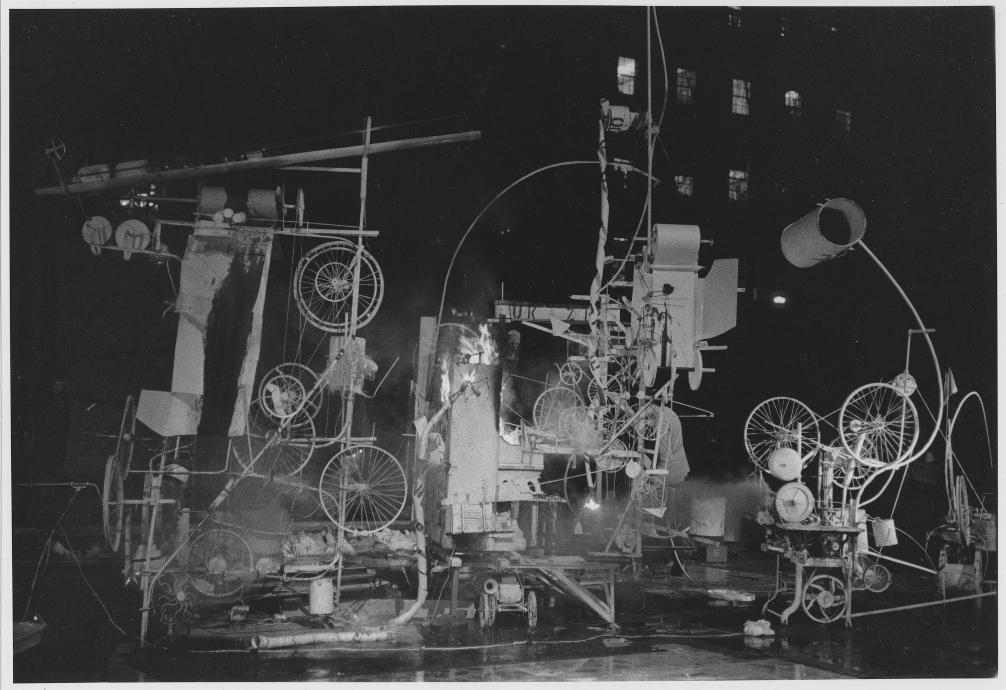 "Installation view of the exhibition, ""Homage to New York:  A self-constructing and self-destroying work of art conceived and built by Jean Tinguely"" March 17, 1960. Photographic Archive. The Museum of Modern Art Archives, New York. IN661.1. Photograph by David Gahr."