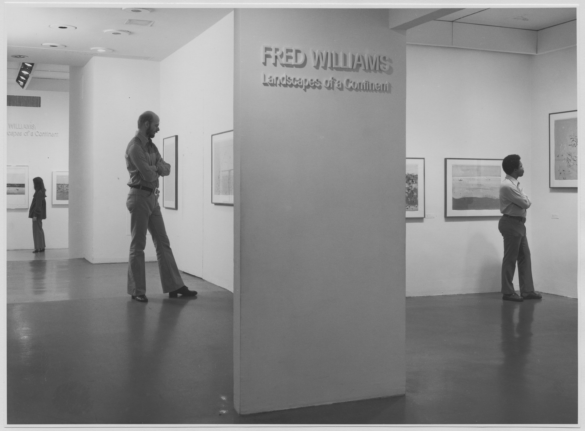"Unidentified visitors at the exhibition, ""Fred Williams:  Landscapes of a Continent."" March 10, 1977–May 8, 1977. Photographic Archive. The Museum of Modern Art Archives, New York. IN1166.1. Photograph by Katherine Keller."