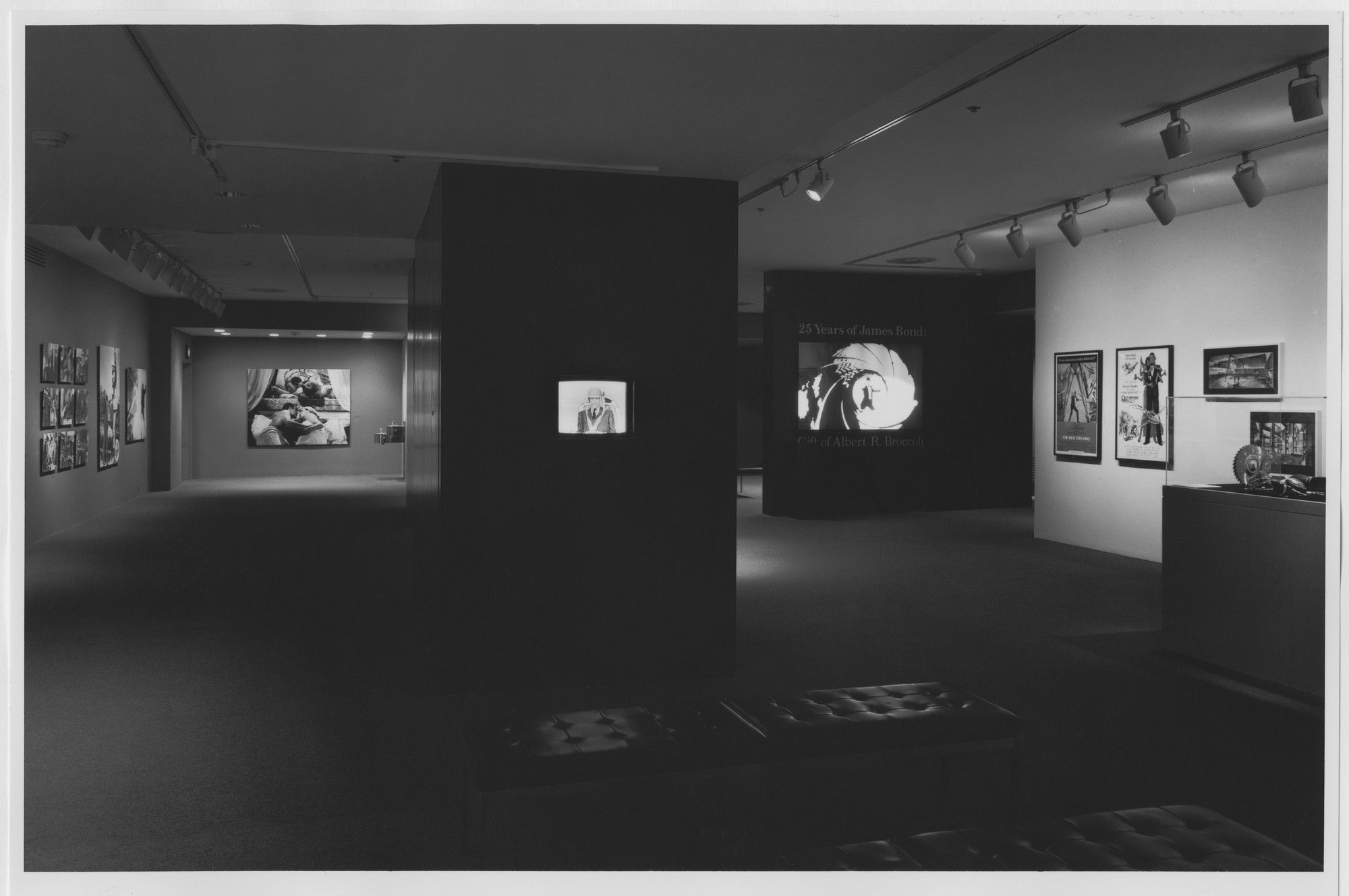 "Installation view of the exhibition, ""25 Years of James Bond: Gift of Albert R. Broccoli "" June 1, 1987–July 5, 1987. Photographic Archive. The Museum of Modern Art Archives, New York. IN1450.1. Photograph by Mali Olatunji."