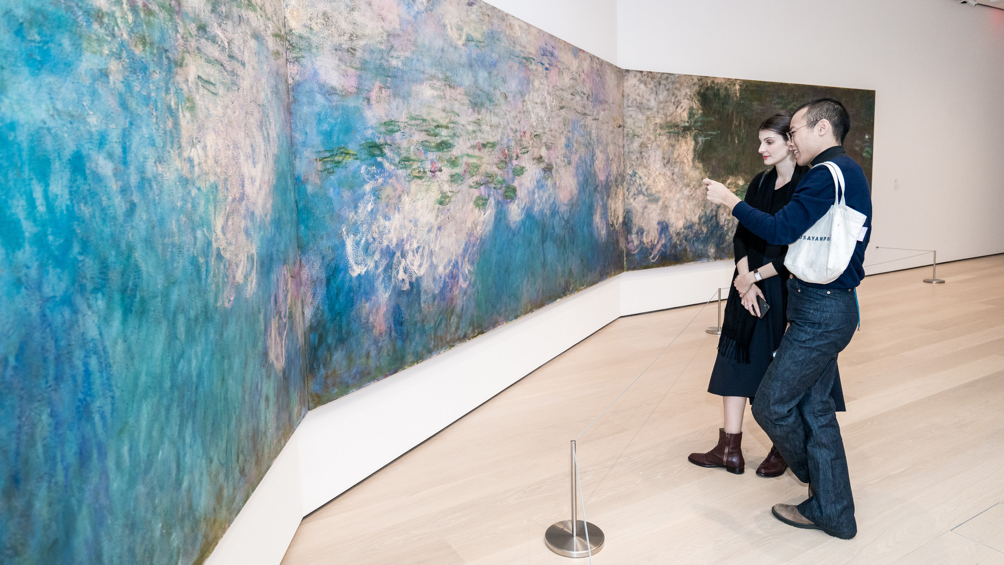 A view of the fifth-floor collection galleries. Shown: Claude Monet. Water Lilies. 1914–26. Oil on canvas, three panels. Mrs. Simon Guggenheim Fund. Photo: Austin Donohue