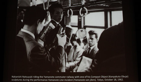 Nakanishi Natsuyuki riding the Yamanote commuter railway with one of his Compact Object (Konpakuto Obuje) sculptures during the performance of Yamanote Line Incident (Yamanote-sen jiken), Tokyo, October 18, 1962