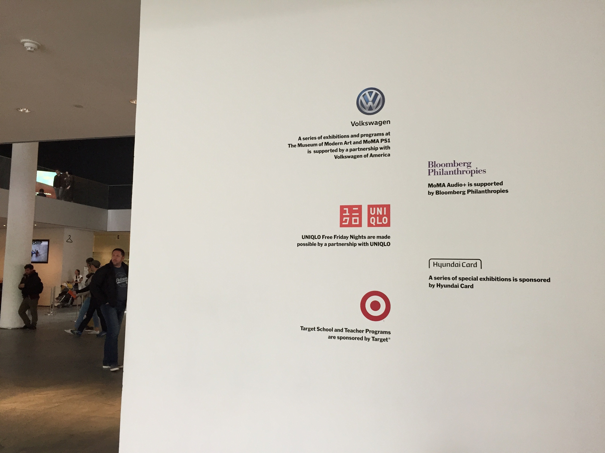Lobby wall showing logos of multi-year partners