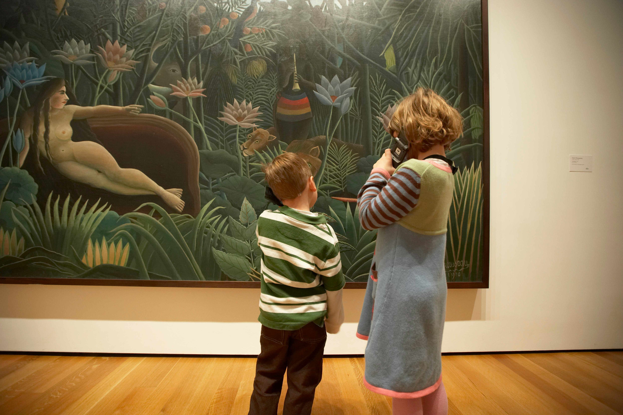 Children listening to MoMA Audio for Henri Rousseau's The Dream. 1910. Oil on canvas. Gift of Nelson A. Rockefeller. © Museum of Modern Art, N.Y. Photo: Jason Brownrigg