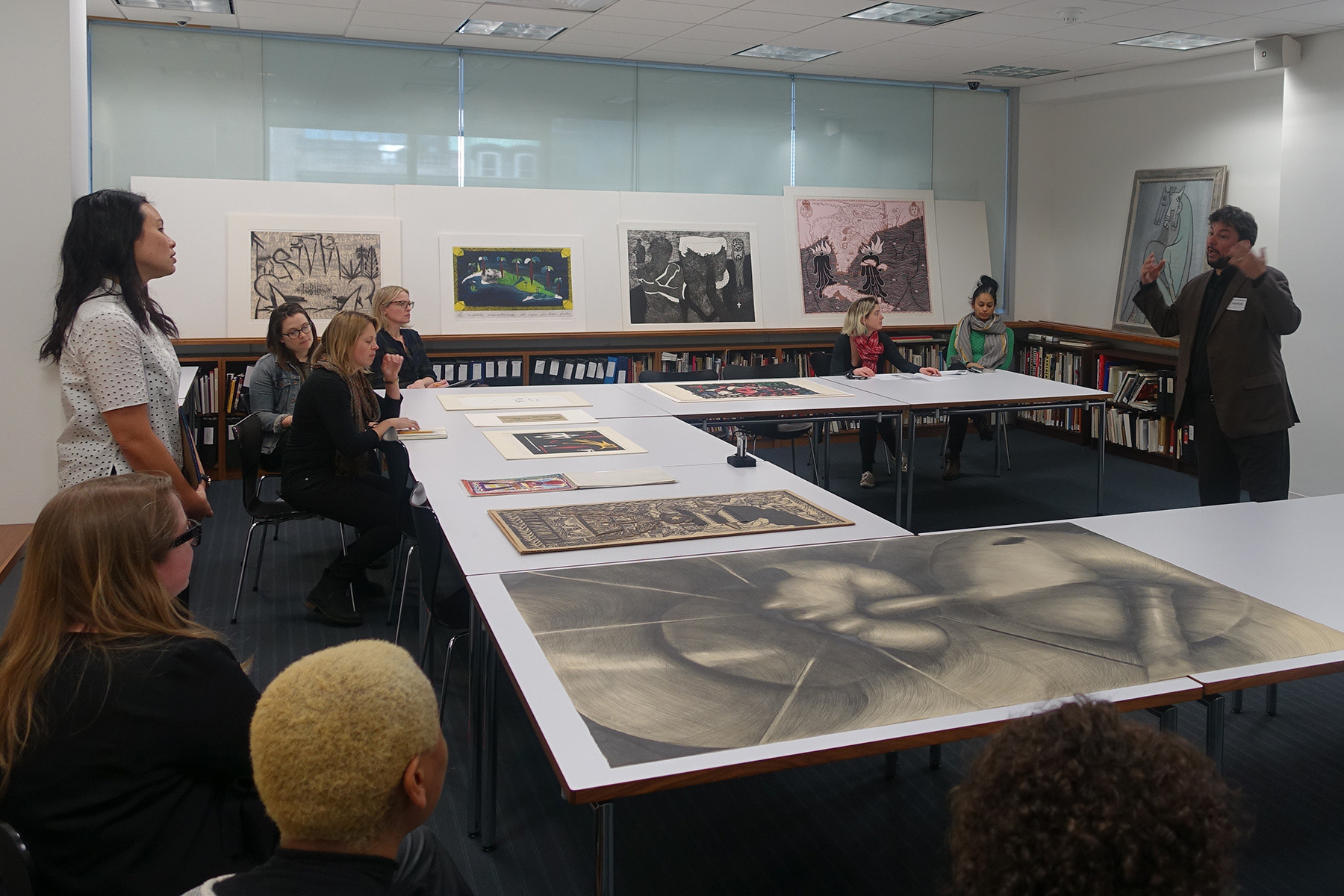 C-MAP Latin America group members viewing works in the Drawing and Prints Study Center at The Museum of Modern Art. March 2018