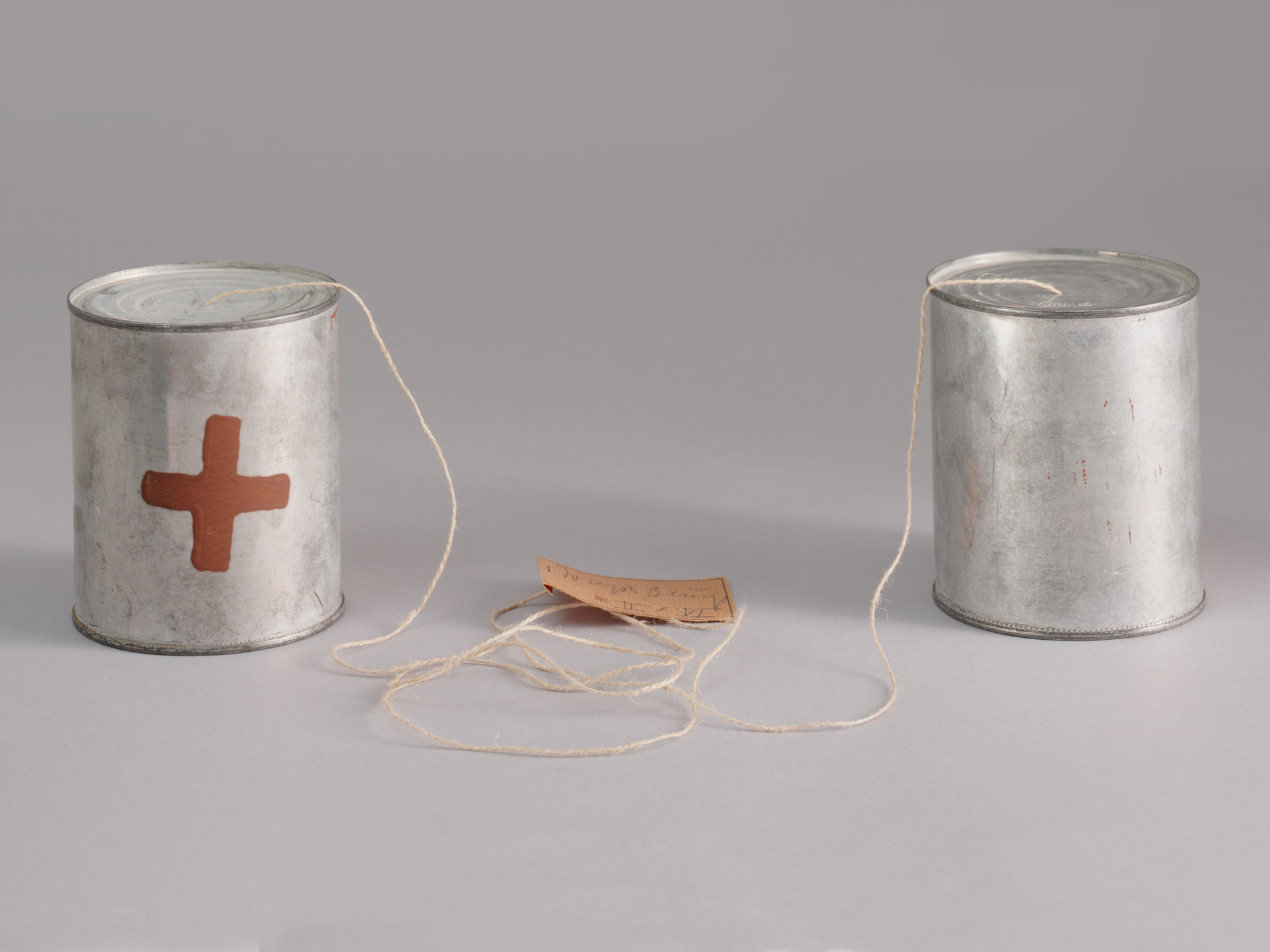 Joseph Beuys. Telephone T–––––R (Telefon S–––––E). 1974. Multiple of two tin cans with paint additions, string, and paper. Riva Castleman Endowment Fund. © 2017 Artists Rights Society (ARS), New York / VG Bild-Kunst, Bonn. Photo: Thomas Griesel