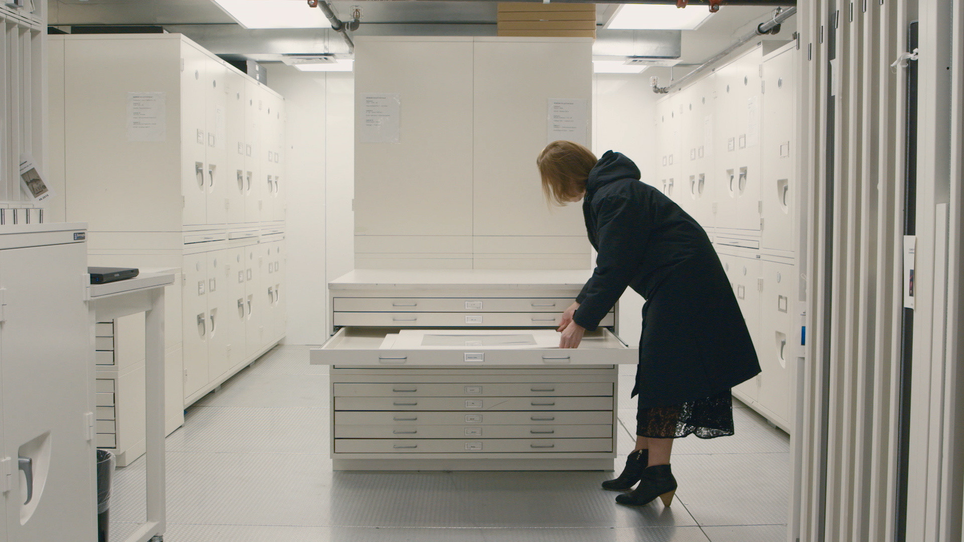 Curator Sarah Meister in photography storage, from the course Seeing Through Photographs. © 2019 The Museum of Modern Art