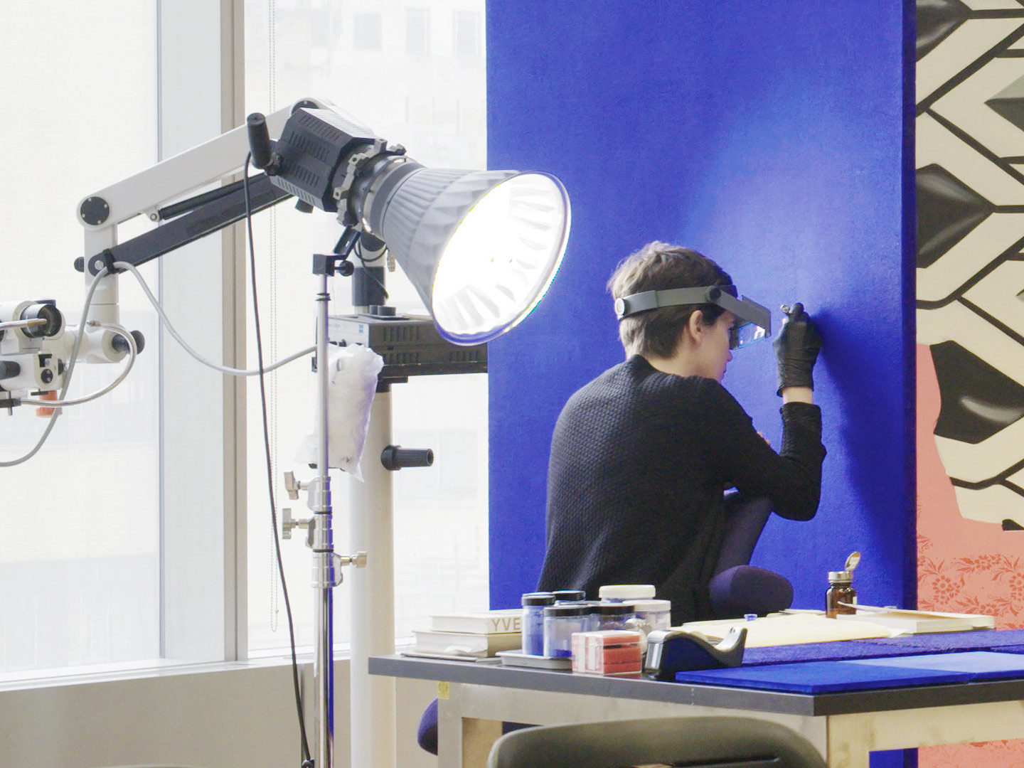 Conservation fellow Ellen Moody working on Yves Klein's Blue Monochrome (1961). Still from MoMA's YouTube series At the Museum. Artwork © 2018 Artists Rights Society (ARS), New York/ADAGP, Paris