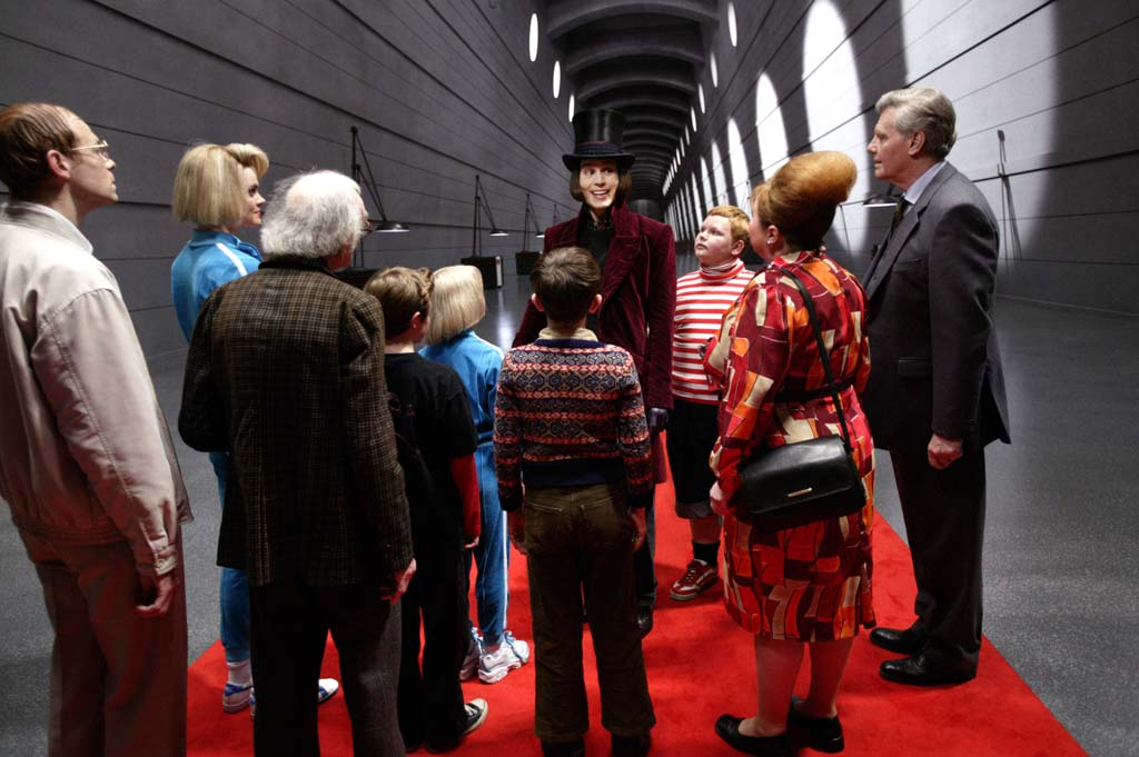 From left to right: Adam Godley, Missi Pyle, David Kelly, Jordan Fry, Annasophia Robb, Freddie Highmore, Johnny Depp, Philip Wiegratz, Franziska Troegner, and James Fox in Warner Bros. Pictures' fantasy adventure <i>Charlie and the Chocolate Factory</i>. USA. 2005. Directed by Tim Burton. Photo by Peter Mountain.