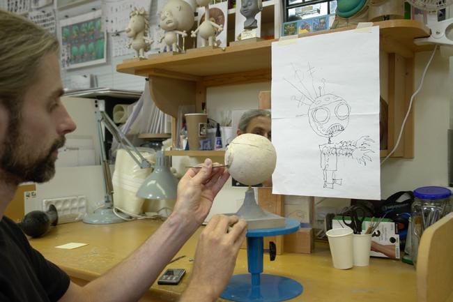 Sculptor/designer Jo Holman renders the robot in modeling clay