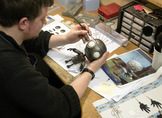 Richard Pickersgill adding the finishing touches to the Robot