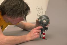 Chris Tichborne helps the Robot pump it up