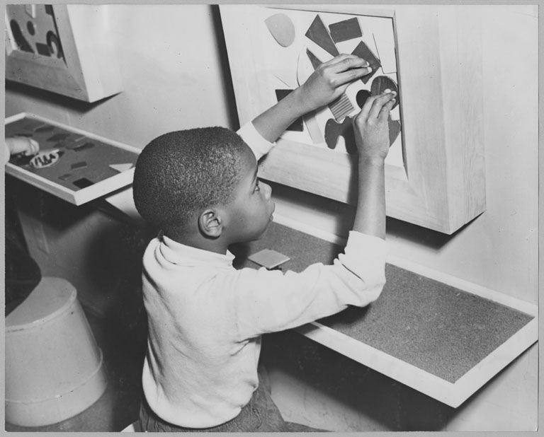 A young partcipant in MoMA's <i>Children's Holiday Carnival of Modern Art,</i> December 5, 1950–January 7, 1951. Photographic Archive. The Museum of Modern Art Archives, New York