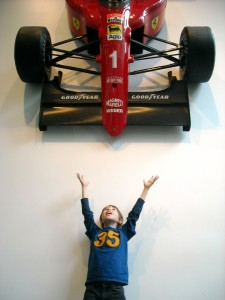 Ethan is delighted by the Formula 1 Racing Car hanging in the Education and Research building lobby.