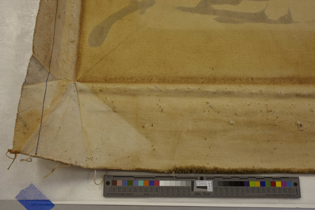 This detail shows the back of Echo with the stretcher removed. The canvas has become darkened and brown where it has been in direct contact with the wood stretcher