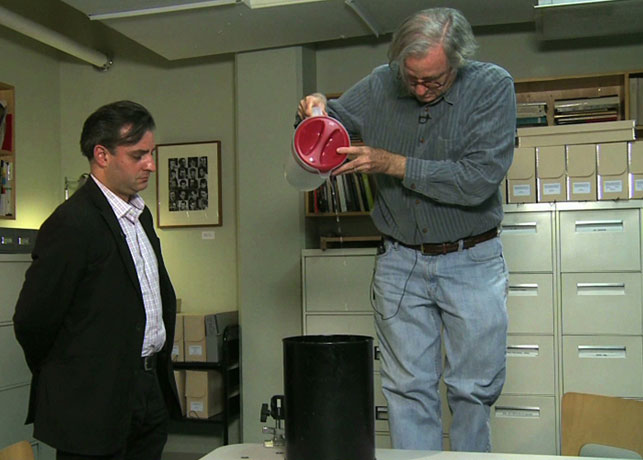 John Hendricks, with instructor Pablo Helguera, pouring water according to a Fluxus score