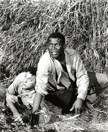 Tony Curtis and Sidney Poitier in The Defiant Ones. 1958. USA. Directed by Stanley Kramer