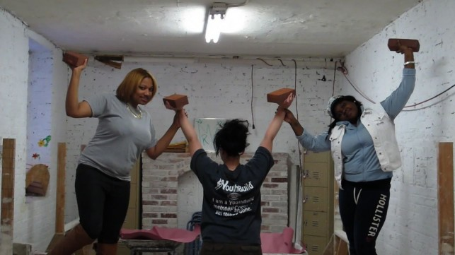 A still image from the ADC YouthBuild video shows students performing at the center.