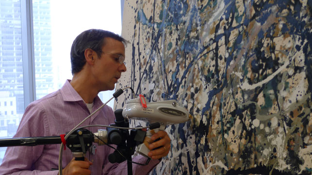 Conservation scientist Chris McGlinchey conducts elemental analysis using a handheld X-ray Fluorescence (XRF) analyzer