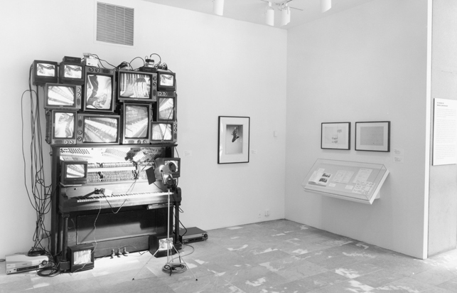 "Nam June Paik. Untitled. 1993. Player piano, fifteen televisions, two cameras, two laser disc players, one electric light and light bulb, and wires. Overall approximately 8' 4"" x 8' 9"" x 48"" (254 x 266.7 x 121.9 cm), including laser disc player and lamp. Bernhill Fund, Gerald S. Elliot Fund, gift of Margot Paul Ernst, and purchase. © 2013 Estate of Nam June Paik"