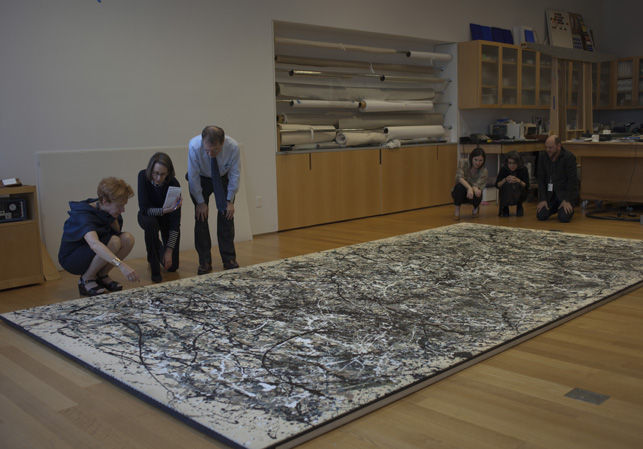 A meeting between conservators and curators to view <em>One: Number 31, 1950</em>