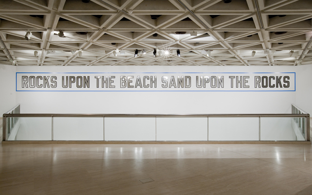 Lawrence Weiner (American, born 1942).  Rocks Upon the Beach Sand Upon the Rocks, 1988. Language + the materials referred to, dimensions variable.  Acquisition from the Werner Dannheisser Testamentary Trust.  © 2013 Lawrence Weiner / Artists Rights Society (ARS), New York.  Installation view, the Art Gallery of Western Australia, 2013