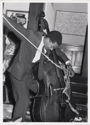 "Variations for Double-Bass, performed during Kleinen Sommerfest/Après John Cage, Galerie Parnass, Wuppertail, June 9, 1962. Gelatin silver print, 13 x 9"" (33 x 22.8 cm). Original photo taken by Rolf Jahrling. Photo: Peter Butler"