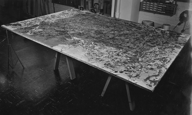 An image of Number 1A undergoing conservation treatment  in 1959. The darkness across much of the canvas is soot deposited during the fire. Here, conservators have begun to clean, working from the edges toward the center