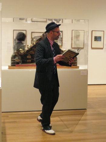 Kenneth Goldsmith performs a guerilla reading in the MoMA galleries. Photo: Jackie Armstrong