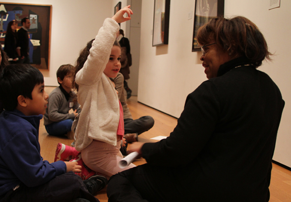 Looking at Surrealist paintings in the Museum's galleries. Photo: Johnny Tan