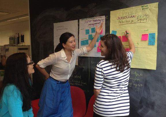 Lisa, Stephanie, and Jessica brainstorm activities to highlight in the course. Photo: Stephanie Pau