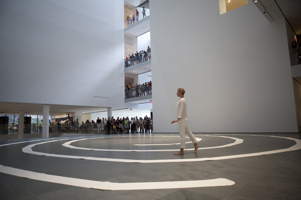 James Lee Byars. The Mile-Long Paper Walk. 1965–2014. Performed at The Museum of Modern Art, August 17, 2014 for the exhibition James Lee Byars. Performed by Katie Dorn; choreographic construction by Lucinda Childs. © 2014 Museum of Modern Art, New York. Photo: Julieta Cervantes