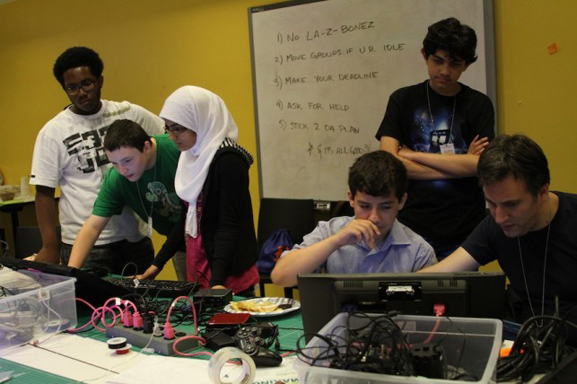 The class finalizing the computers and games for the show