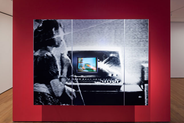 Dara Birnbaum. PM Magazine (detail). 1982. Four-channel video (color, three channels of stereo sound; 6:30 min.), two chromogenic prints, Speed Rail® structural support system, aluminum trim, one wall painted Chroma Key Blue, and one wall painted red, dimensions variable. The Museum of Modern Art, New York. Acquired with support from The Modern Women's Fund Committee, The Contemporary Arts Council of The Museum of Modern Art, and through the generosity of Ahmet Kocabiyik. © 2014 Dara Birnbaum. Courtesy the artist and Marian Goodman Gallery, New York and Paris. Installation view, Cut to Swipe, The Museum of Modern Art, October 11, 2014–March 22, 2015. Digital image © The Museum of Modern Art, New York. Photo: Jonathan Muzikar
