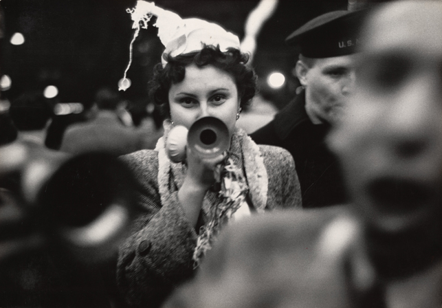 "Dan Weiner. New Year's Eve, Times Square. 1951. Gelatin silver print, 9 1/4 x 13 3/16"" (23.5 x 33.5 cm). The Museum of Modern Art, New York. Gift of Sandra Weiner. © 2014 Estate of Dan Weiner, courtesy of Sandra Weiner"