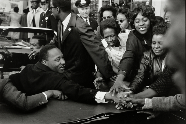 """Leonard Freed.  Baltimore, Maryland: Dr. Martin Luther King, Jr. being greeted upon his return to the United States after receiving the Nobel Peace Prize. October 31, 1964. Gelatin silver print, 14 1/4 x 21 3/16"""" (36.2 x 53.8 cm). The Museum of Modern Art, New York. Acquired through the generosity of Thomas L. Kempner, Jr. © 2015 Leonard Freed/Magnum Photos"""