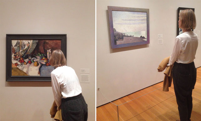 "Dianna Molzan in the galleries. Shown, from left: Paul Cézanne (French, 1839–1906). Still Life with Apples. 1895–98. Oil on canvas, 27 x 36 1/2"" (68.6 x 92.7 cm). Lillie P. Bliss Collection; Georges-Pierre Seurat (French, 1859–1891). Evening, Honfleur. 1886. Oil on canvas, with painted wood frame, 30 3/4 x 37"" (78.3 x 94 cm) including frame. Gift of Mrs. David M. Levy"