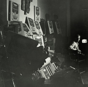 Andy Warhol at his 1342 Lexington Avenue studio with Campbell's Soup Cans, 1962. Collection The Andy Warhol Museum, Pittsburgh