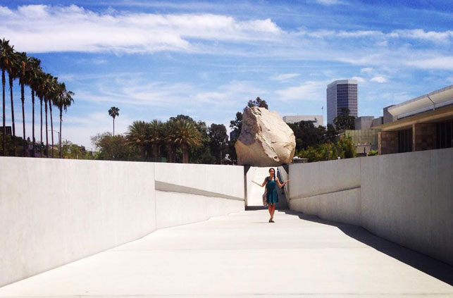The author poses with Michael Heizer's sculpture Levitated Mass at the Los Angeles County Museum of Art. Photo: Kerri Kearse