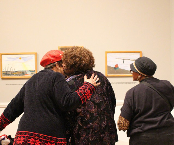 Participants from Elders Share the Arts (ESTA) viewing the exhibition One-Way Ticket: Jacob Lawrence's Migration Series and Other Visions of the Great Movement North