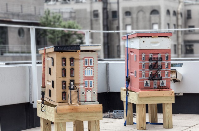 Two beehives, modeled like city buildings, are kept on a nearby rooftop in case additional honeybees are required during the exhibition of Untilled. Photo The Museum of Modern Art