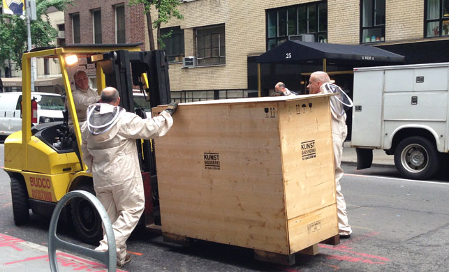 The crated sculpture is unloaded from the truck on West 54 Street. Photo: Margaret Ewing