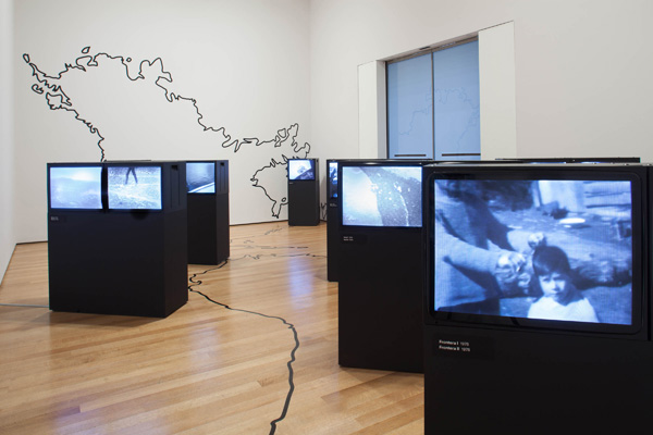Juan Downey. Video Trans Americas. 1973–76. Fourteen-channel video (black and white, sound; duration variable) and vinyl map. The Museum of Modern Art, New York. Acquired through the generosity of the Latin American and Caribbean Fund and Baryn Futa in honor of Barbara London. © 2015 Estate of Juan Downey & Marilys B. Downey.  Installation view, Transmissions: Art in Eastern Europe and Latin America, 1960–1980, The Museum of Modern Art, New York, September 5, 2015–January 3, 2016. Photo: Thomas Griesel