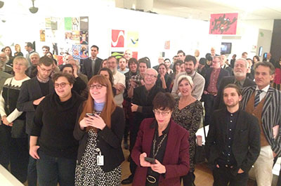 The crowd watches the Scopitone on the opening night of Making Music Modern. Photo by Bob Orlowsky