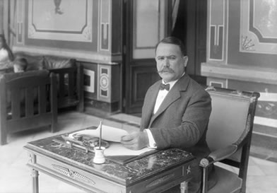 Photo of Obregón at writing desk