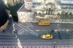 James Bridle (British, b. 1980) and Einar Sneve Martinussen (Norwegian, b. 1982). Drone Shadow 002, Istanbul, Turkey, 2012. Road-marking paint. 49' x 30' (15 x 9 m). Drone Shadow 003, Brighton, UK, 2013. Road-marking paint. 66' x  36' (20 x 11m). Image courtesy of James Bridle/booktwo.org. Photo by James Bridle