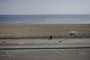 James Bridle (British, b. 1980) and Einar Sneve Martinussen (Norwegian, b. 1982). Drone Shadow 003, Brighton, UK. 2013. Road-marking paint. 66' x 36' (20 x 11m). Image courtesy of Roberta Mataityte/Lighthouse. Photo by James Bridle